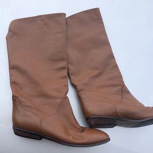 Worn but still life left. Brown calf high boots